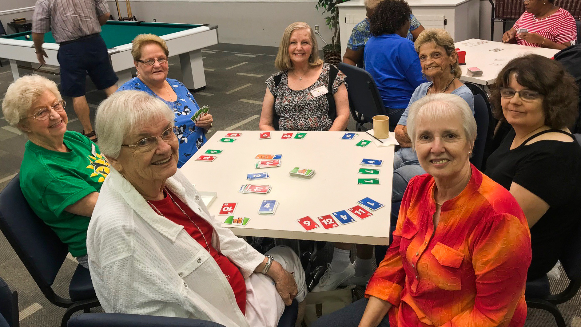 Active Life members piecing puzzles at the center